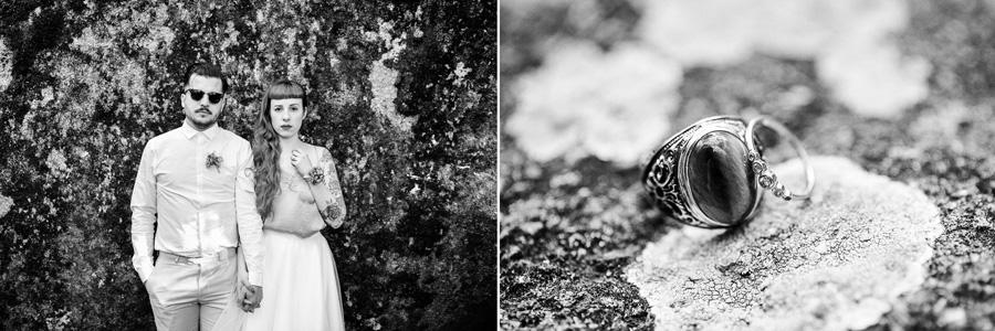 Un couple pose devant un rocher. Des bagues sont posées sur de la roche