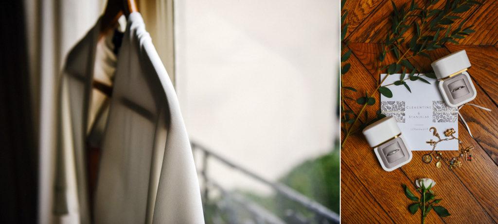 La robe de la mariée posée sur un cintre et la carterie du mariage