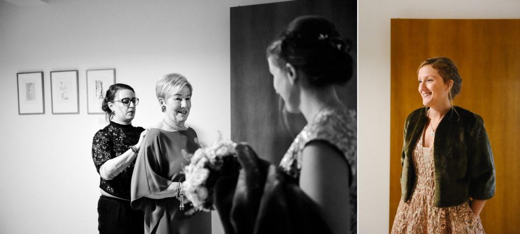 La maman de la mariée regarde sa fille en robe